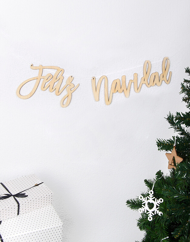 Cartel Guirnalda Feliz Navidad para decorar el rincón dónde los Reyes Magos dejarán sus regalos, o sobre el Belén. Descubre toda la decoración naviknots