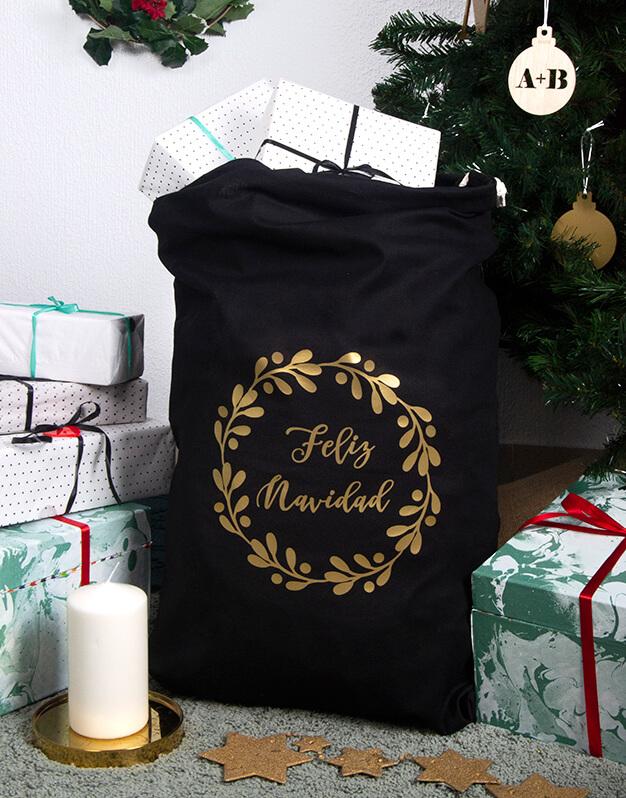 Saco Feliz Navidad diseño elegante con opción a personalizarlo con el nombre. Este diseño sirve tanto para regalos de Papá Noel como Reyes Magos.
