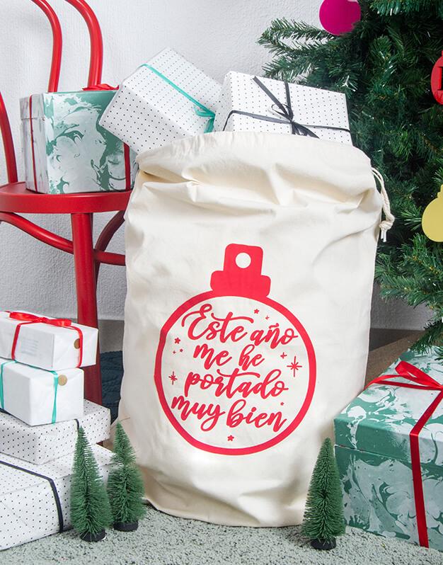 Saco Navidad bola con mensaje con opción a personalizarlo con el nombre. Este diseño sirve tanto para regalos de Papá Noel como Reyes Magos.
